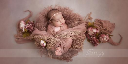 houston metro newborn girl in pink wrap